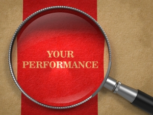Your Performance through Magnifying Glass on Old Paper with Red Vertical Line.